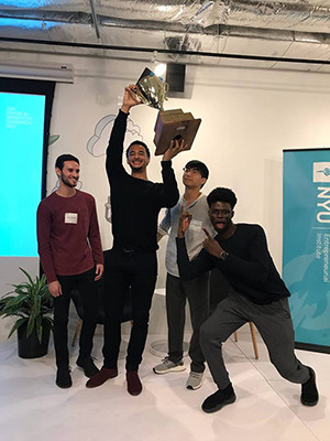 Victor Hunt and cofounders celebrating their win